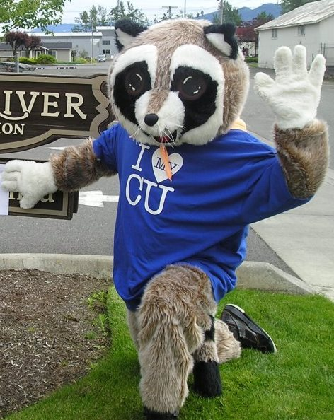 "raccoon mascot posing next to white river credit union sign with shirt on that says ""i heart my CU"""