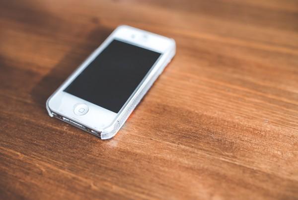 Phone on wood desk
