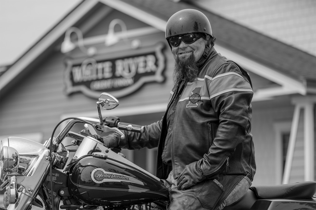 man on motorcycle in front of White River Credit Union