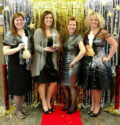 WRCU employees dressed in Oscars costumes