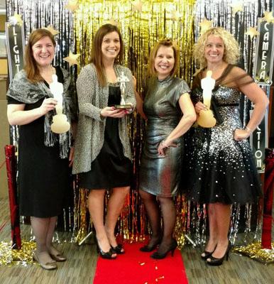 WRCU employees dressed in Oscars costumes