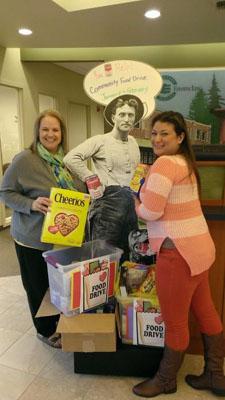 WRCU posing with food drive donated supplies