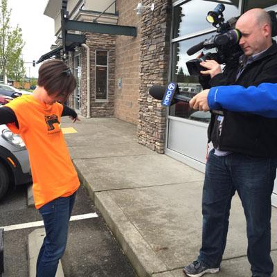 man filming women showing her clothing