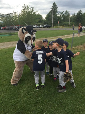 Raccoon mascot with a boys baseball team