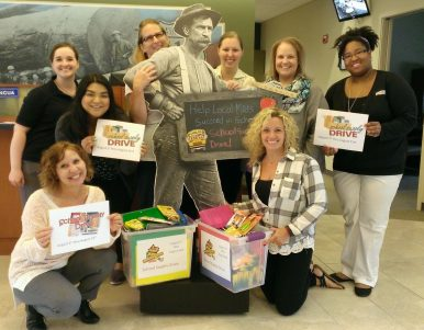 WRCU team posing with the school supply drive donated supplies
