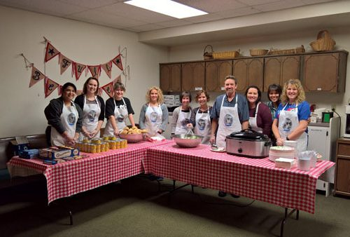 WRCU employees in aprons in a kitchen