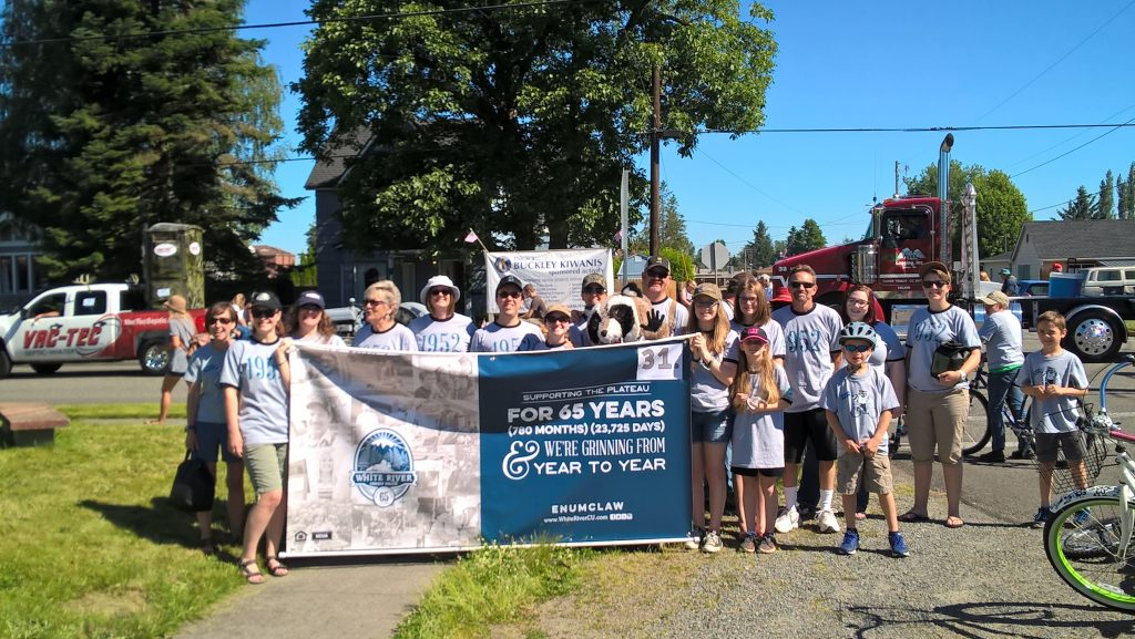 WRCU team posing outside with a banner