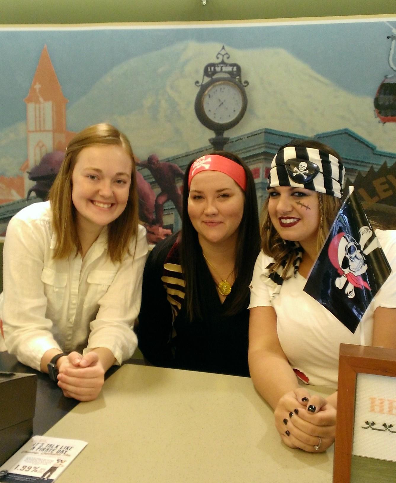 women posing dressed as pirates