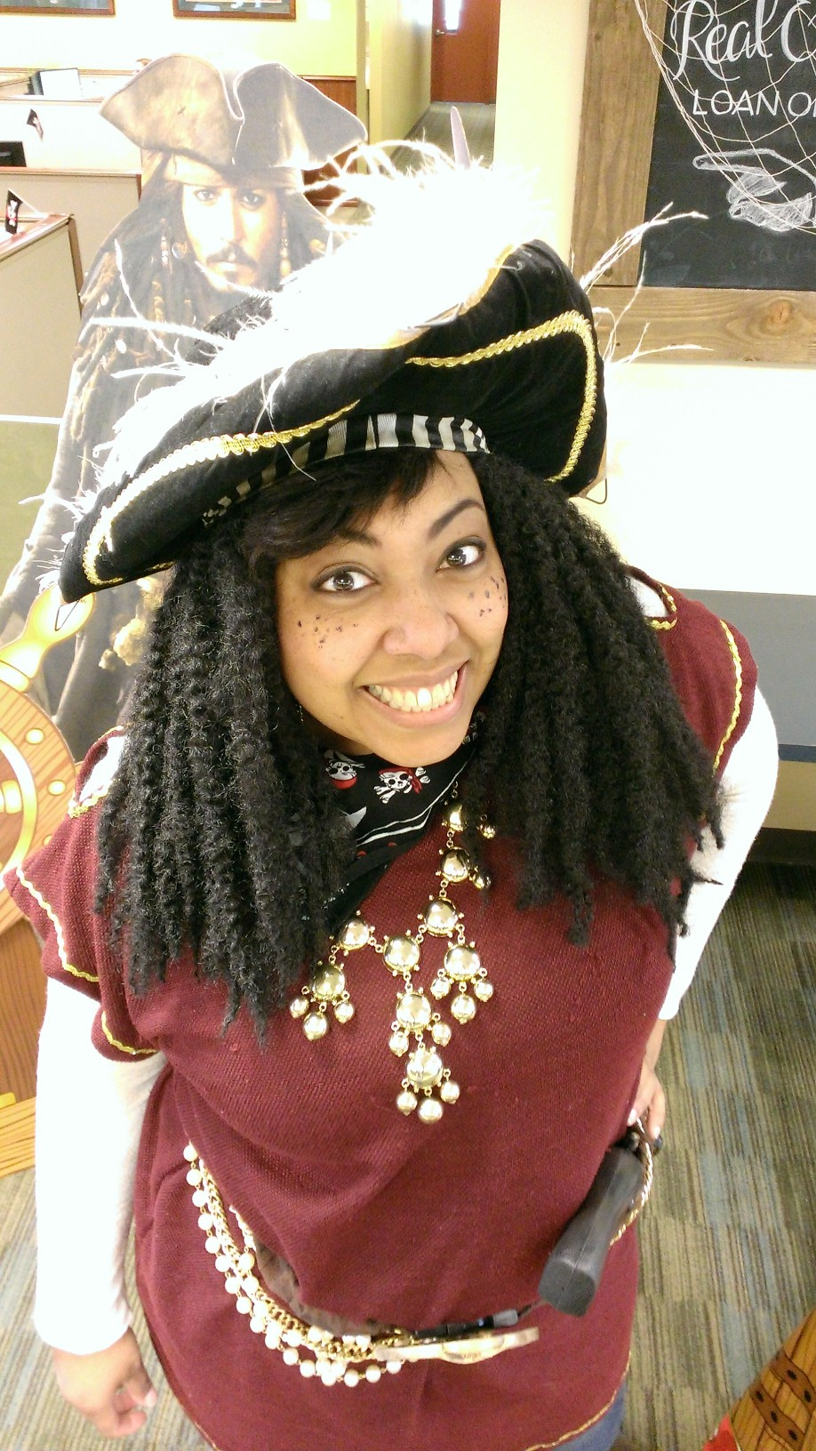 woman posing dressed as a pirate