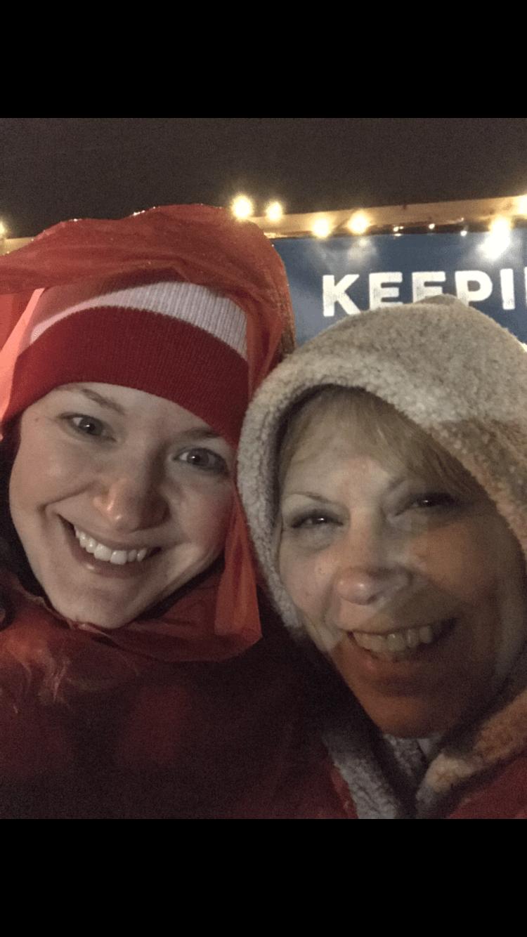 women smiling outside