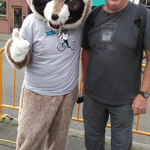 Rocky Raccoon standing with a man