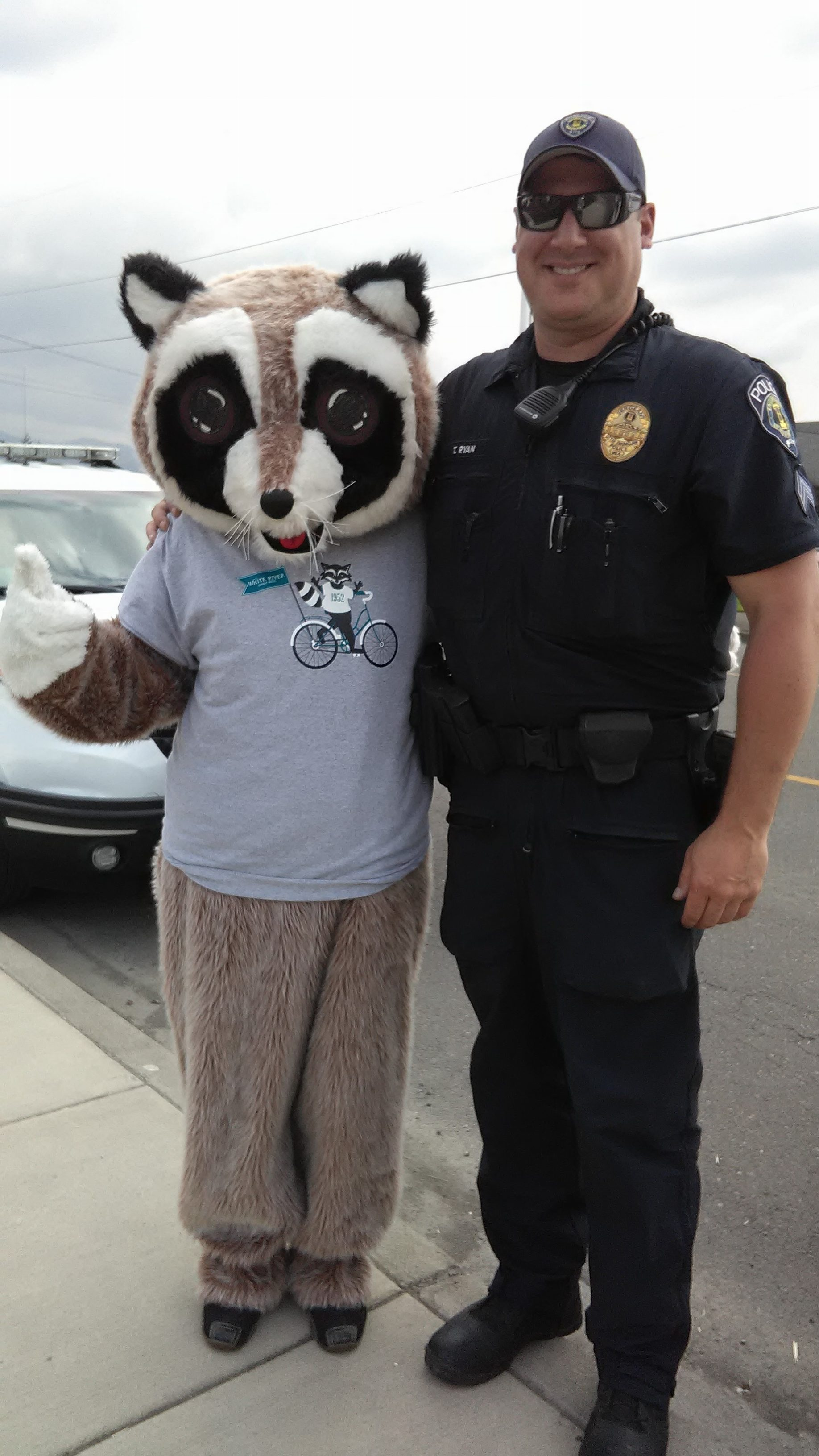 Rocky Raccoon with police officer