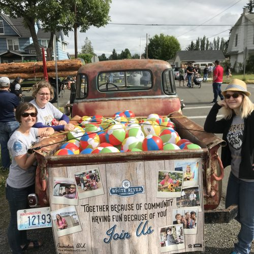 WRCU staff standing next to truck with beach balls