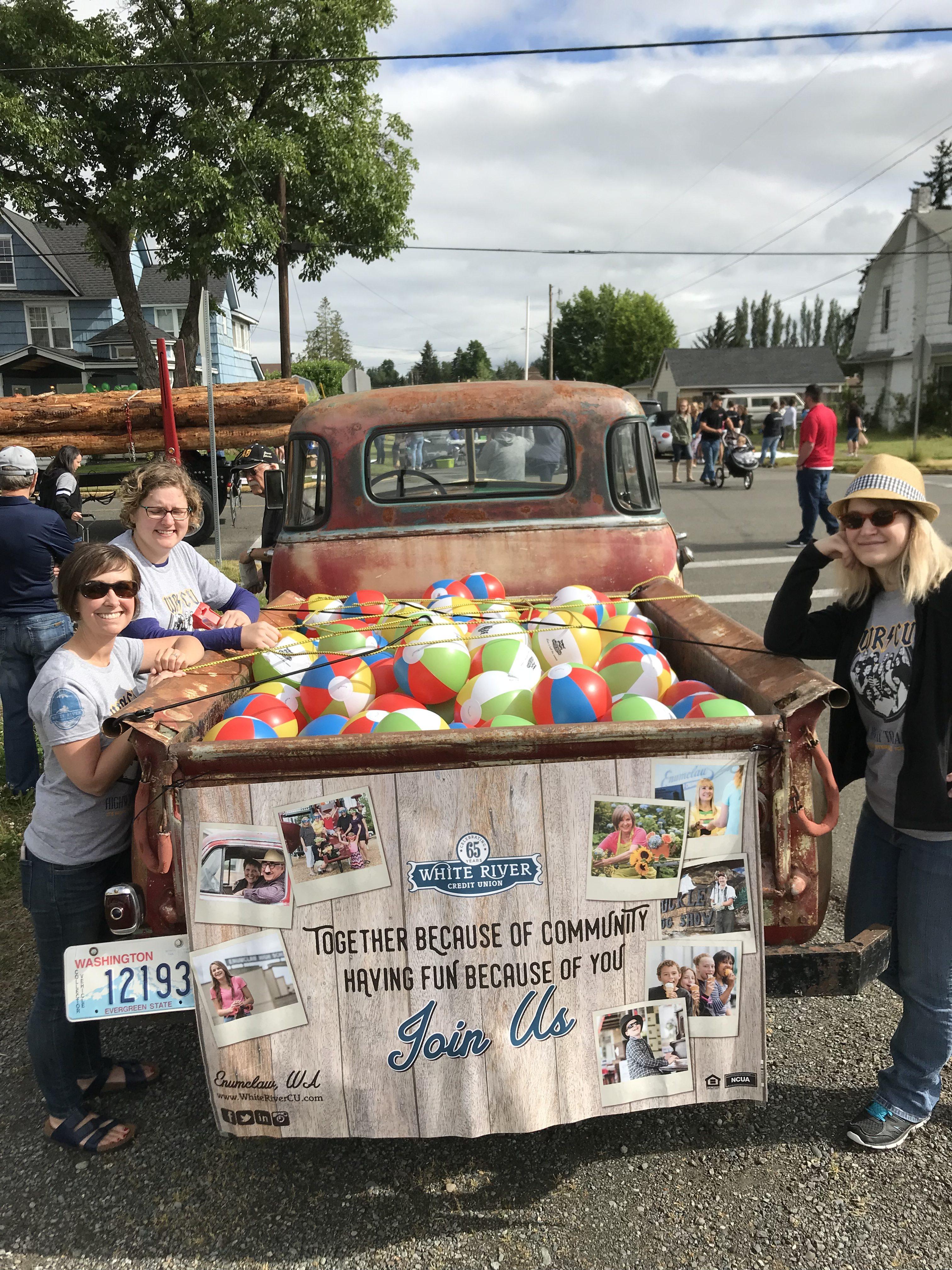 WRCU staff standing next to truck with beach balls