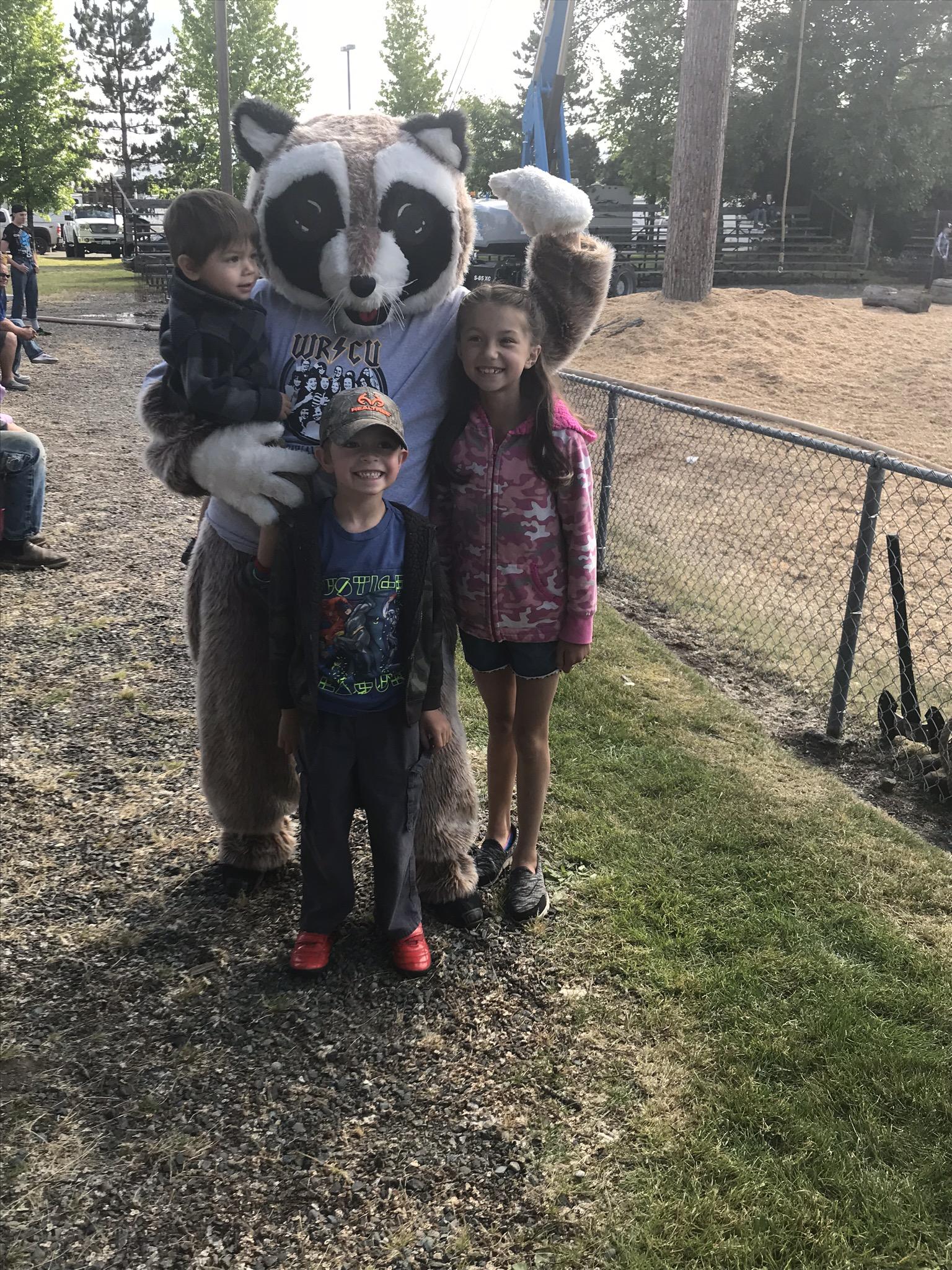 Rocky Raccoon with three kids