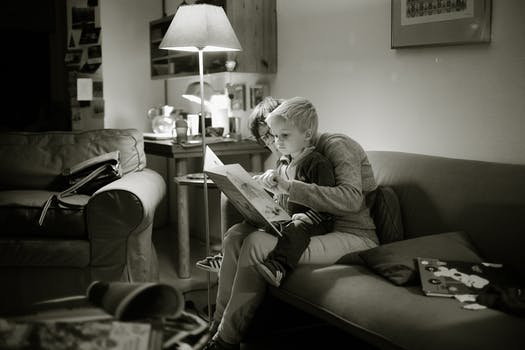 Grandma reading to small child