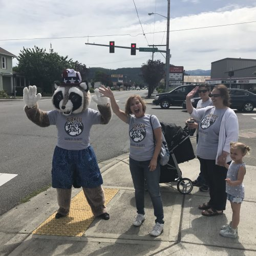 Rocky Raccoon and WRCU team waving