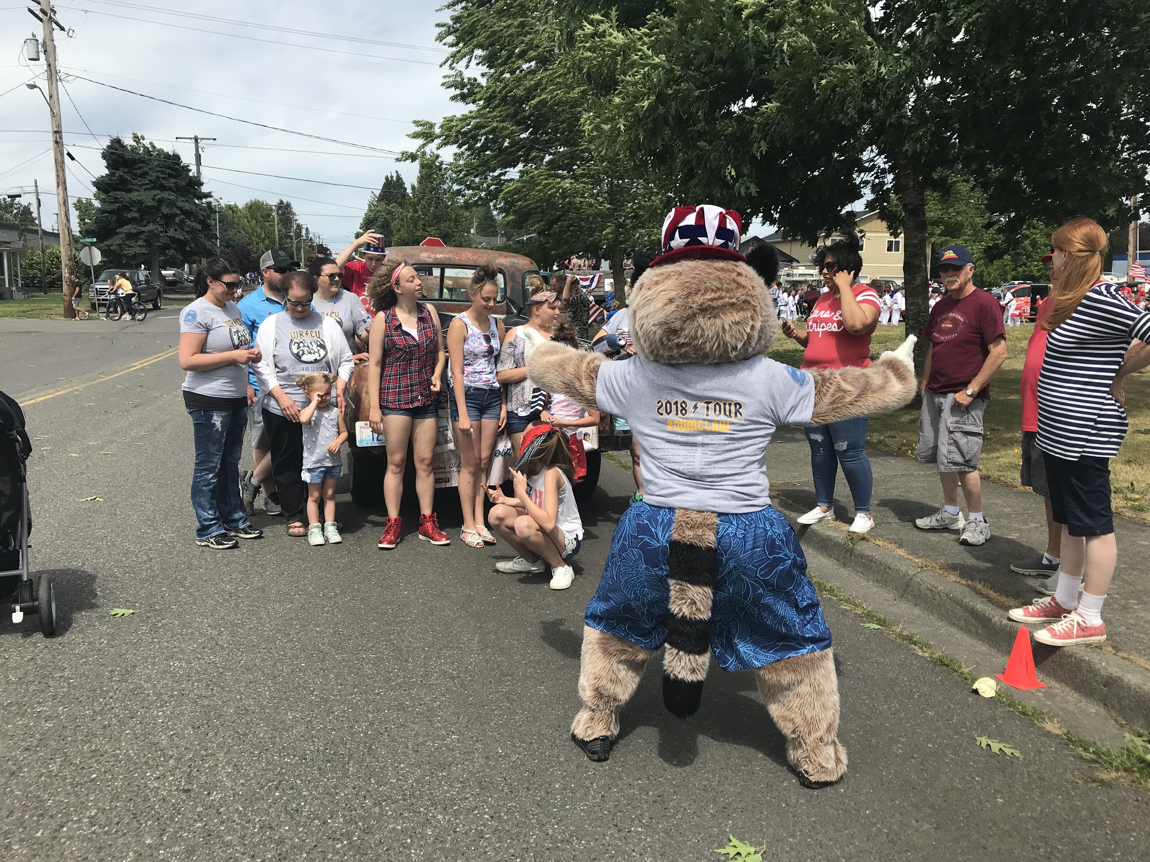 Rocky Raccoon standing in front of kids