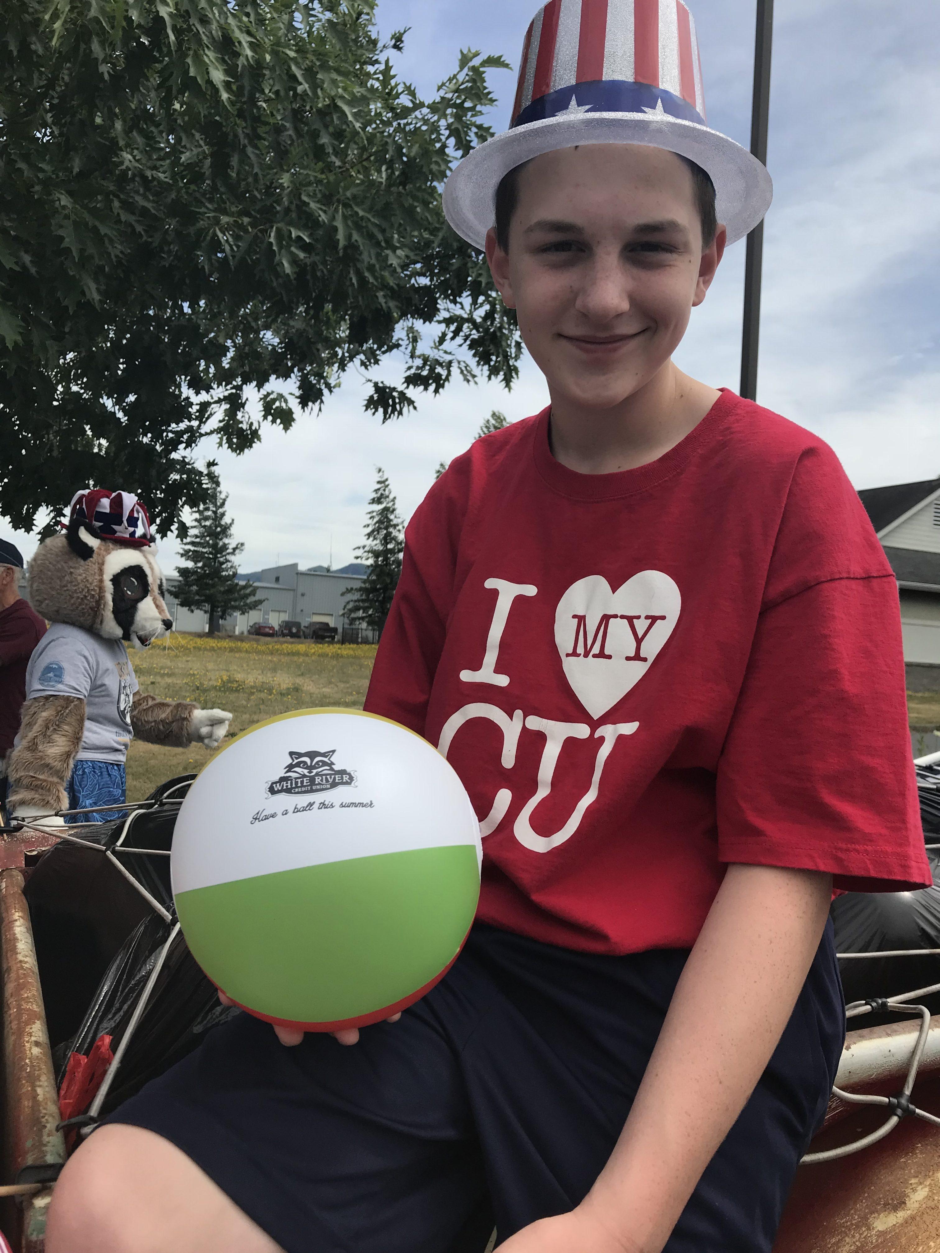 Boy holding a beach ball