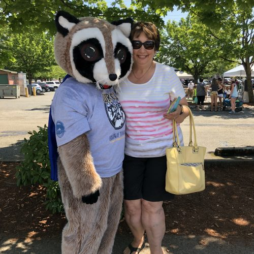 Rocky Raccoon standing with woman