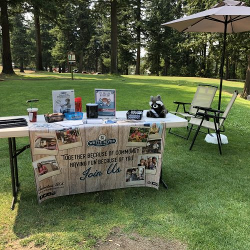 WRCU booth at golf tournament