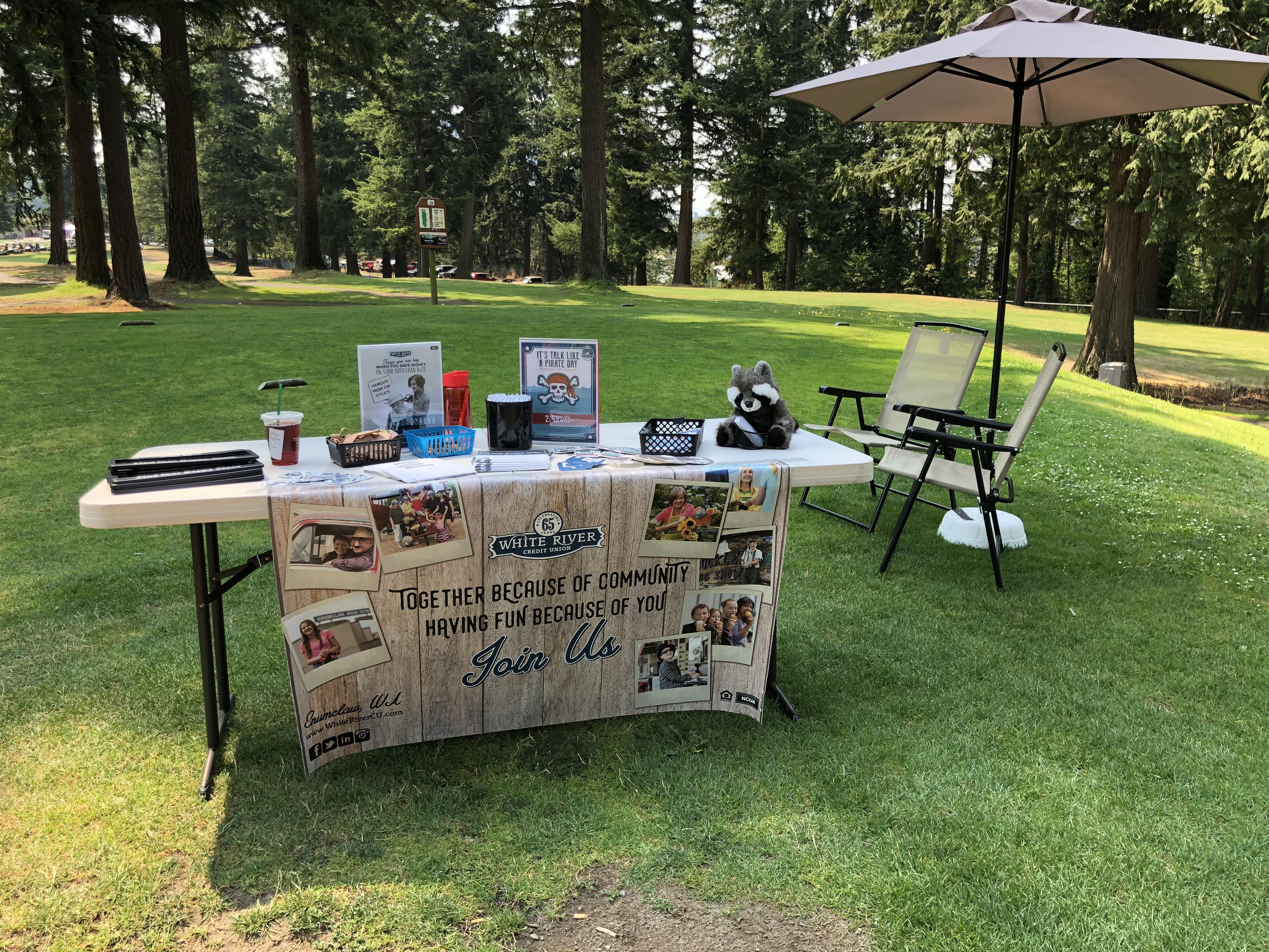 WRCU booth at golf tournament