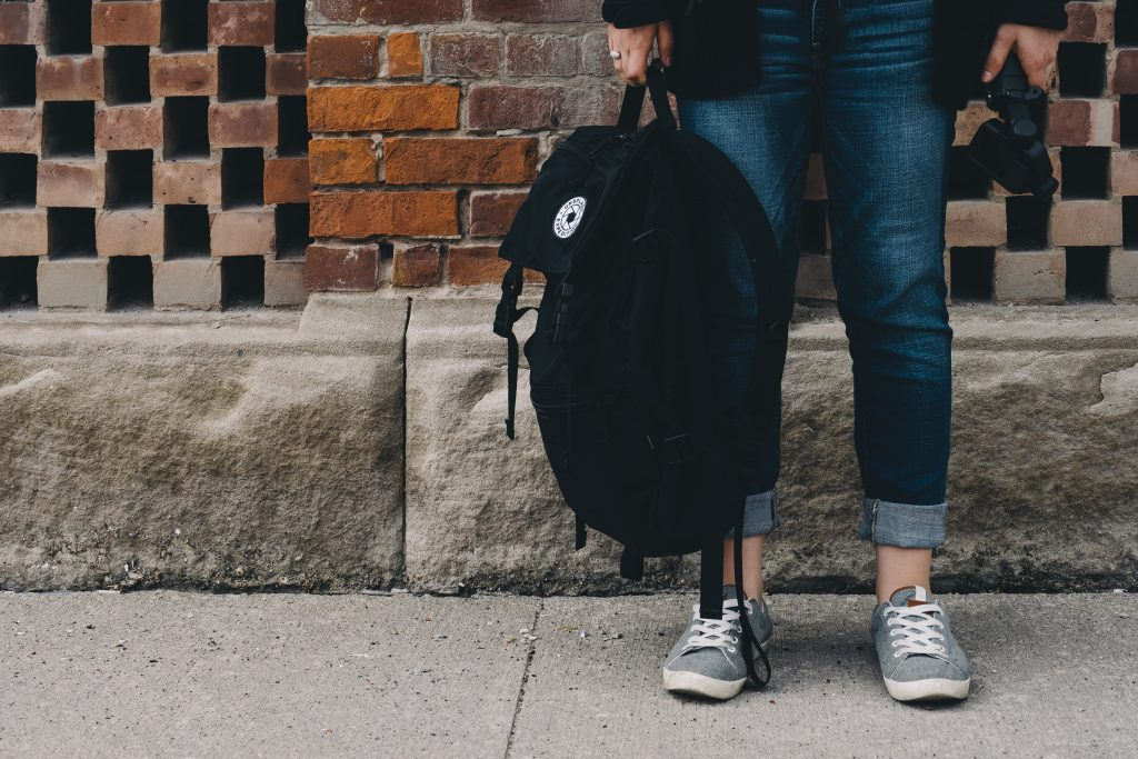 College student standing with a backpack