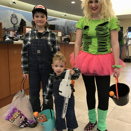 Kids and lady dressed up for Halloween