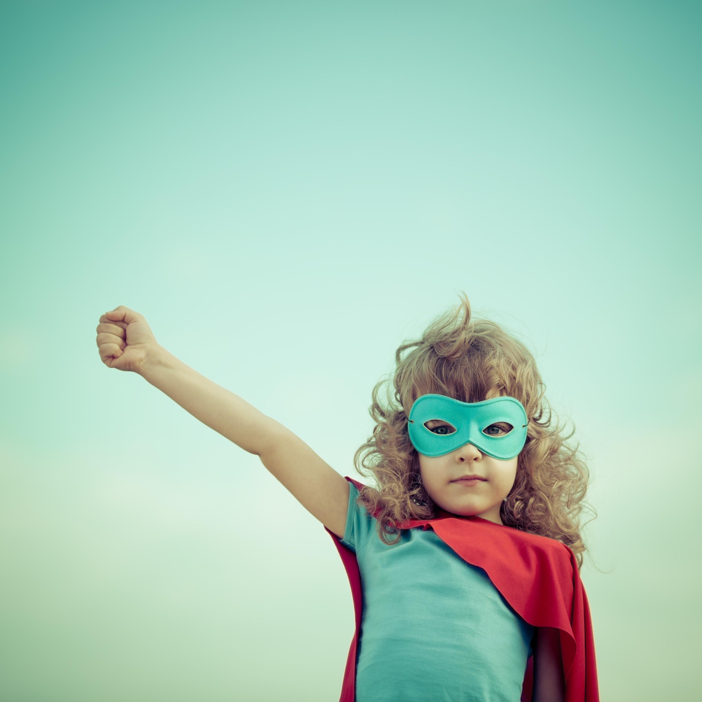 Little girl with cape like a superhero