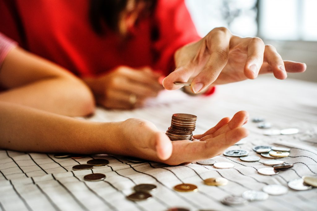 adults budgeting with coins