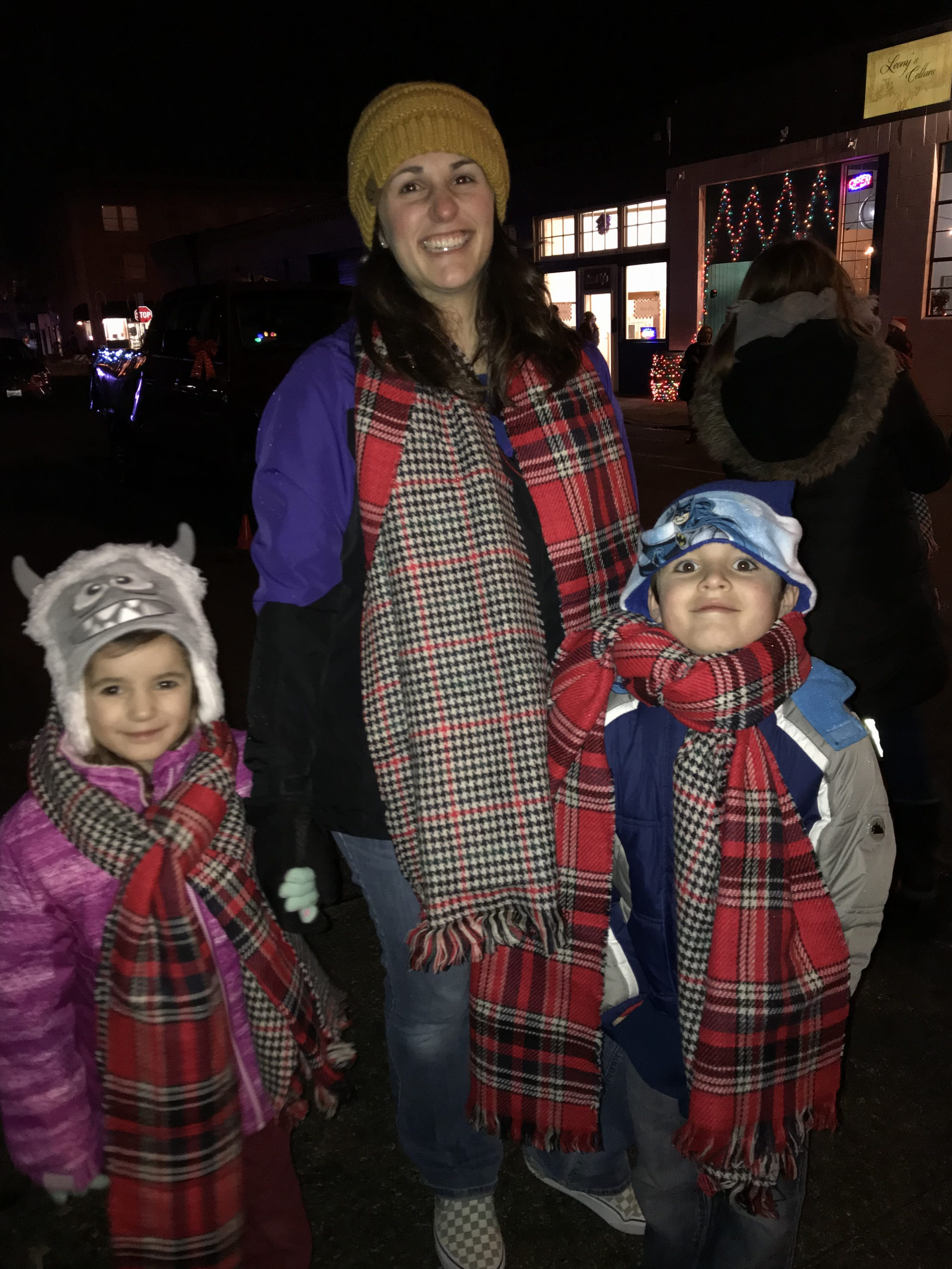 A mom and two kids dressed warmly