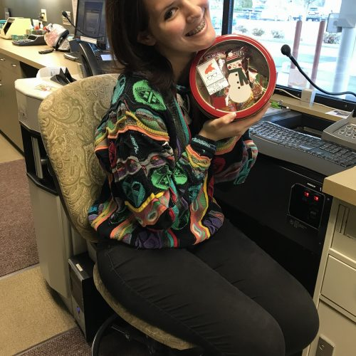 WRCU employee with bowl of treats