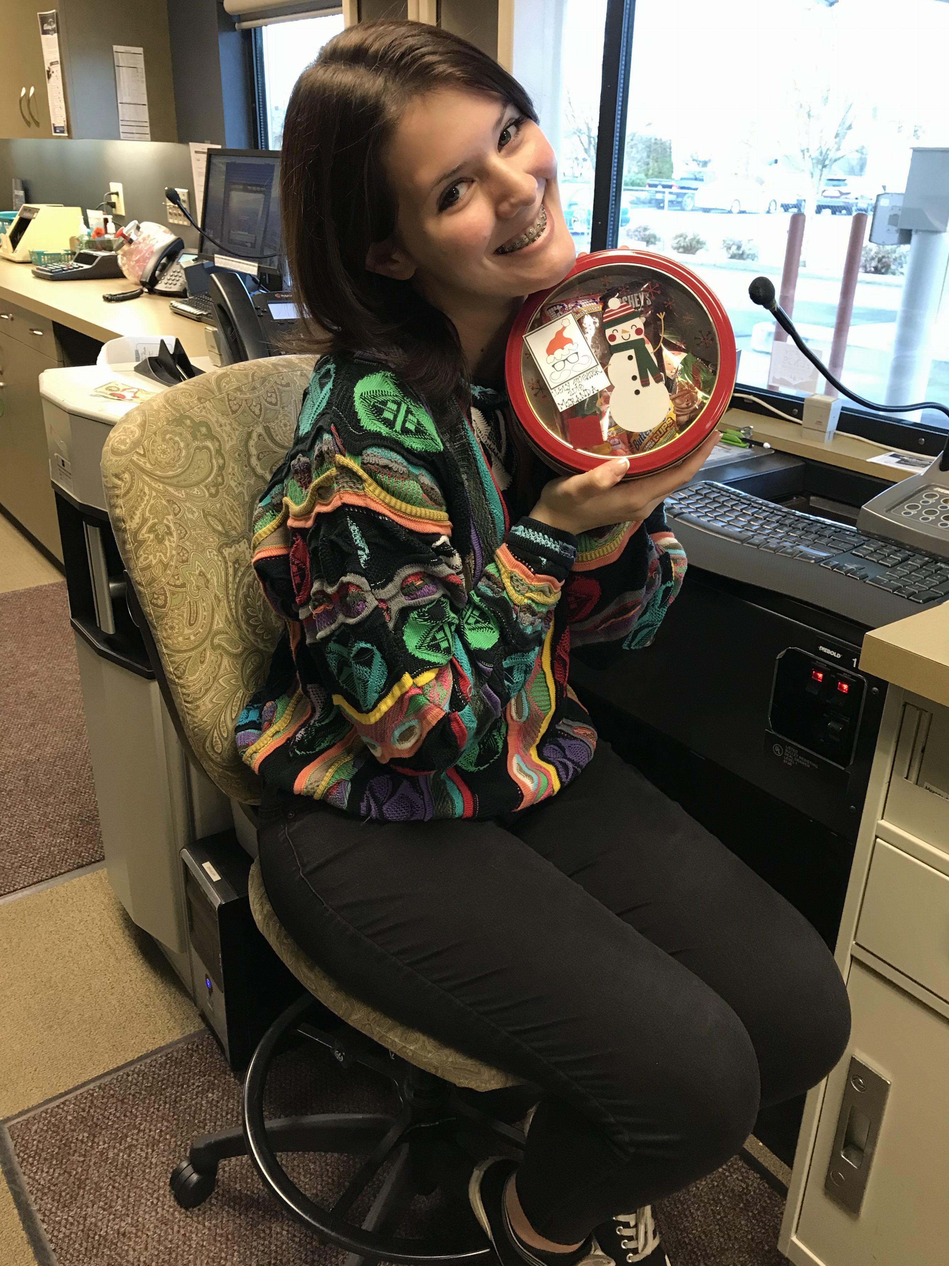 WRCU employee with bowl of treats