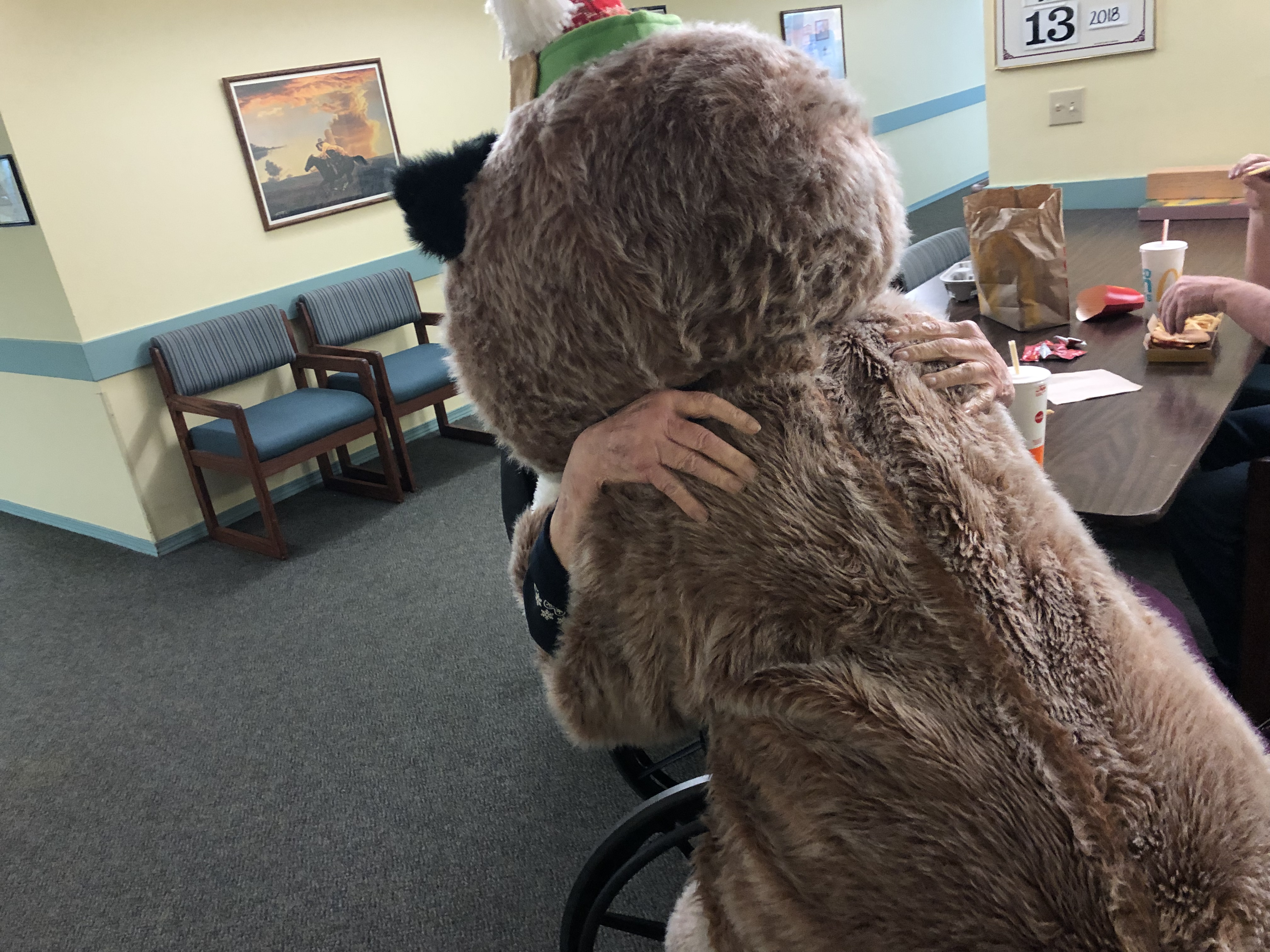 Rocky hugging senior