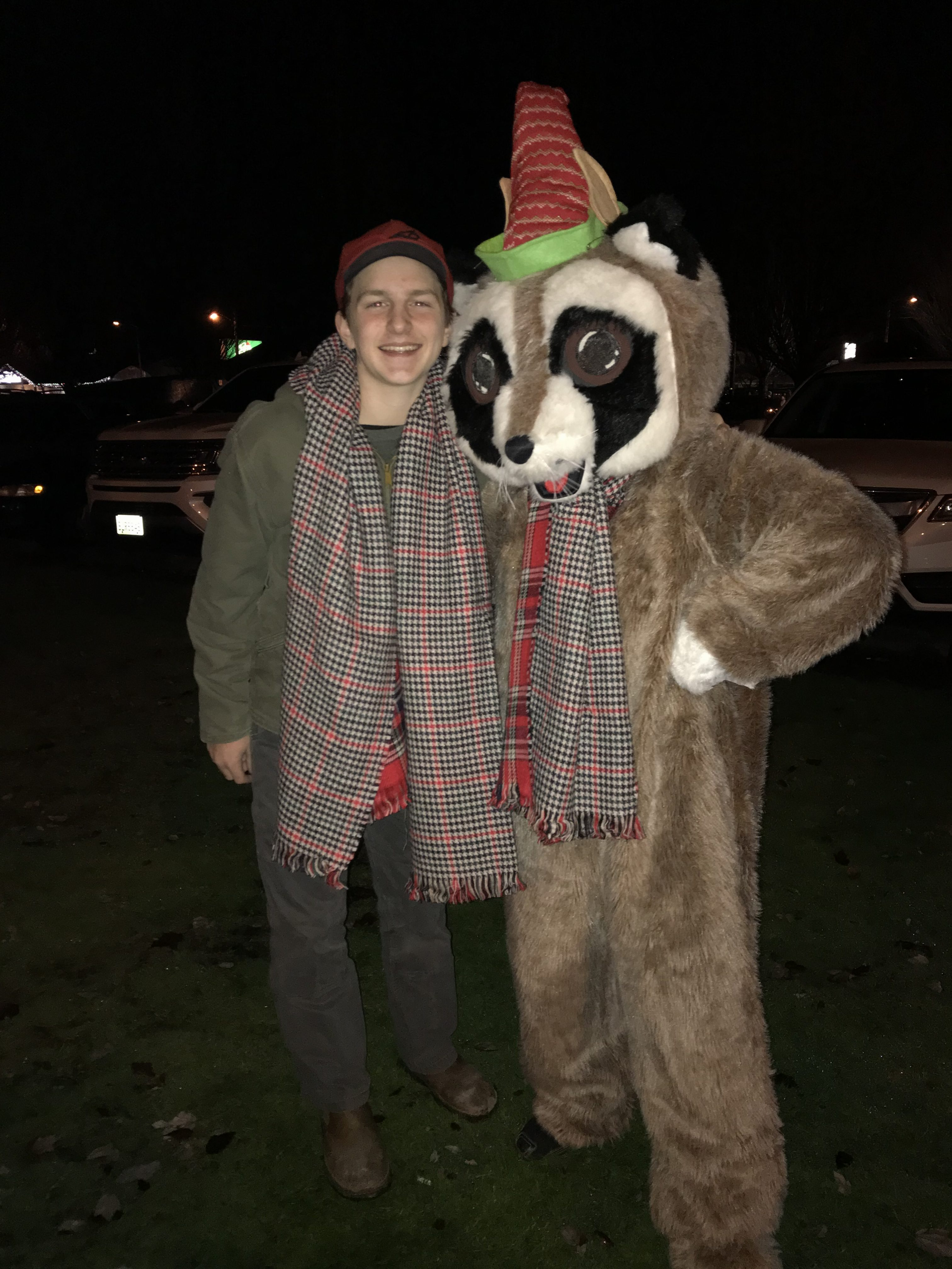 Rocky Raccoon standing with boy