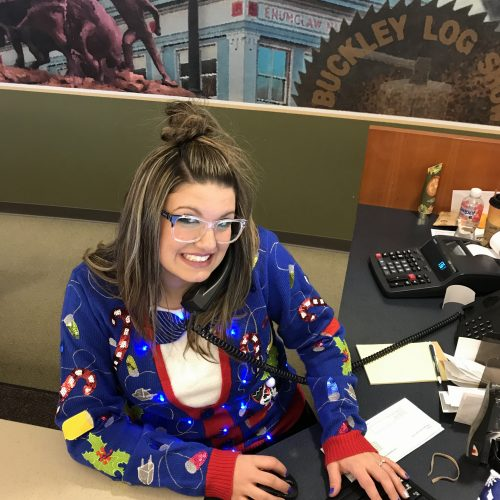 WRCU staff member in blue ugly sweater