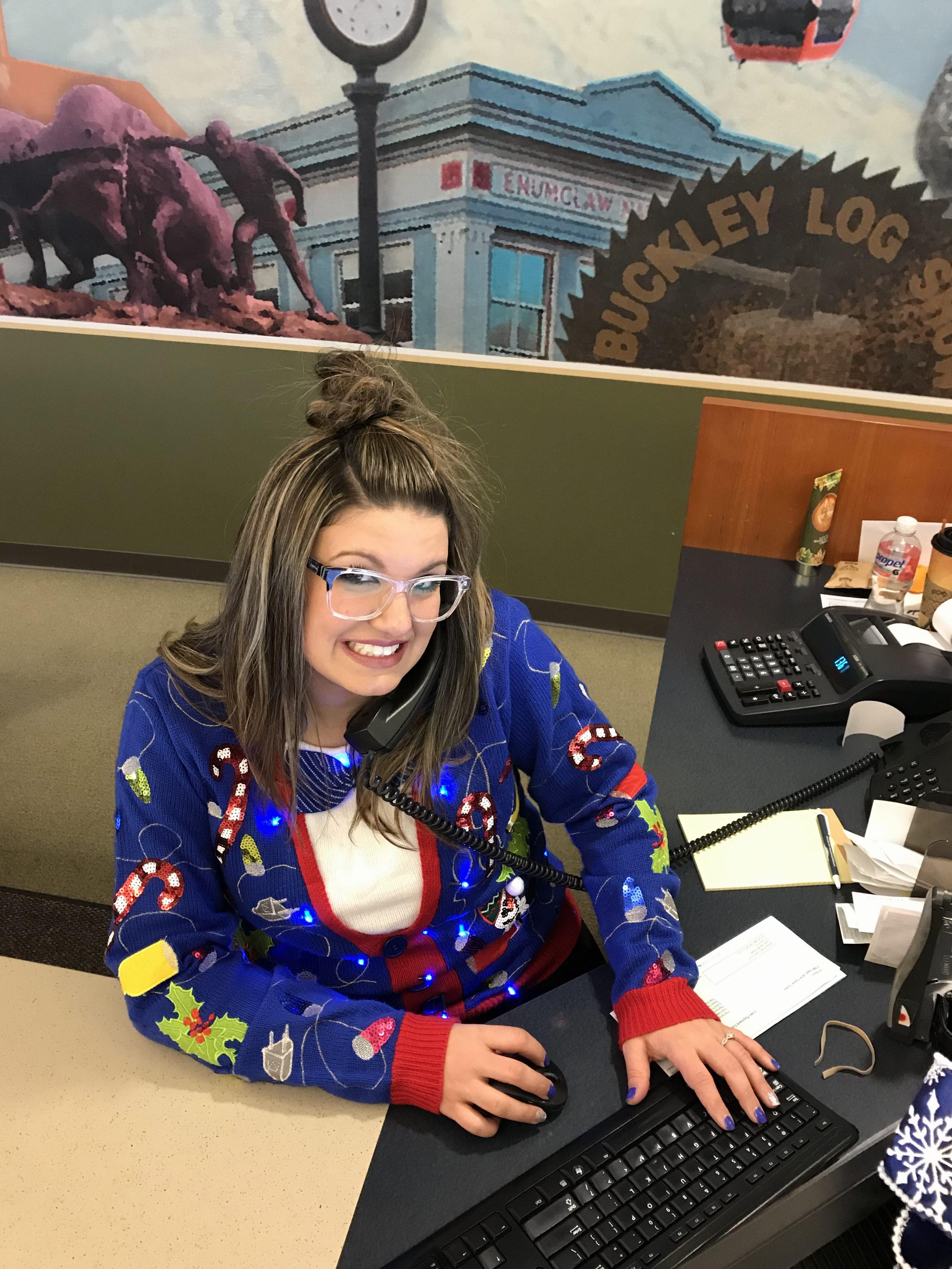 WRCU staff member in blue ugly sweater