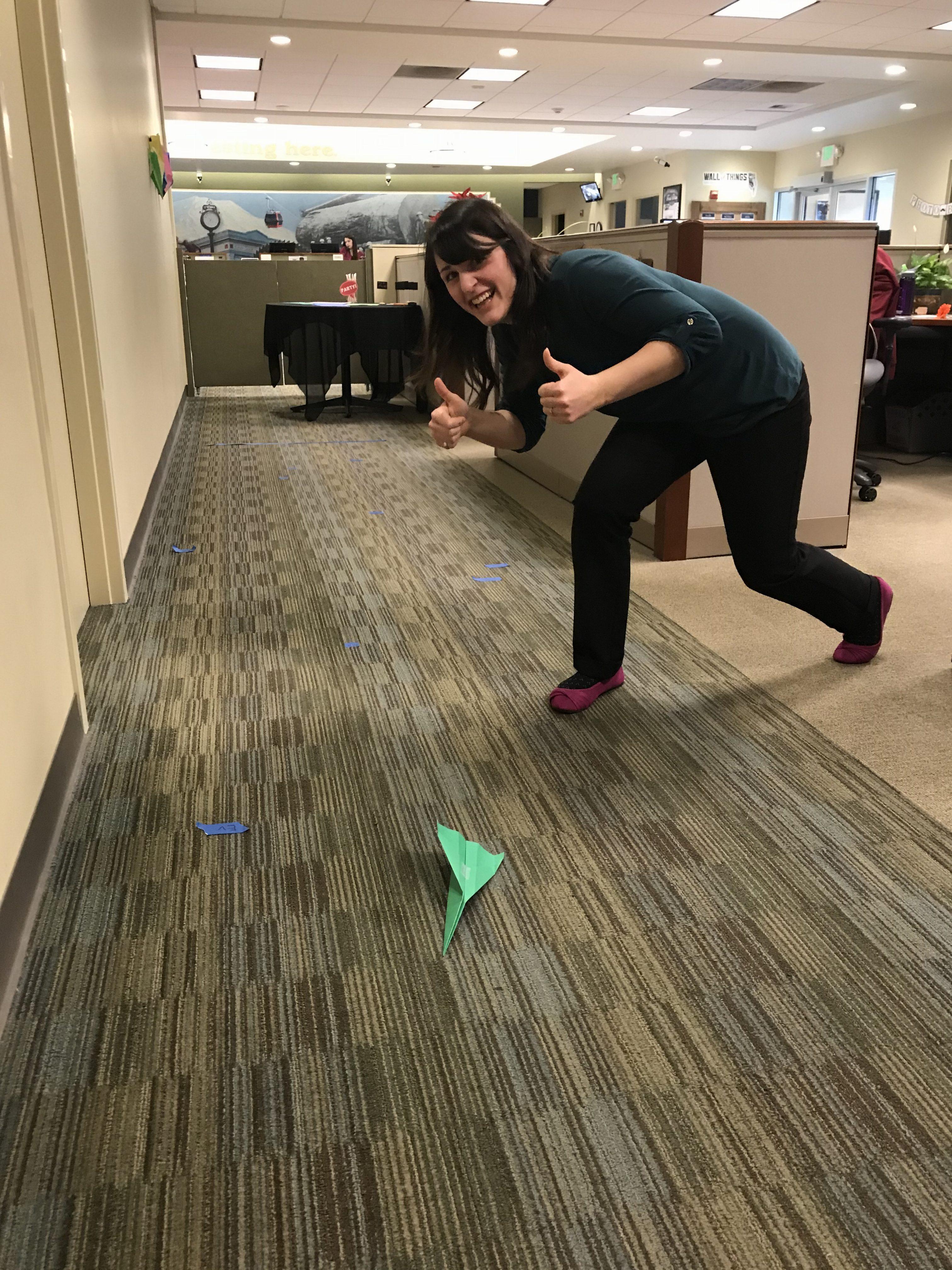 WRCU staff member throwing paper airplane