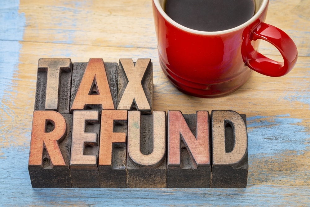 tax refund made out of wooden blocks