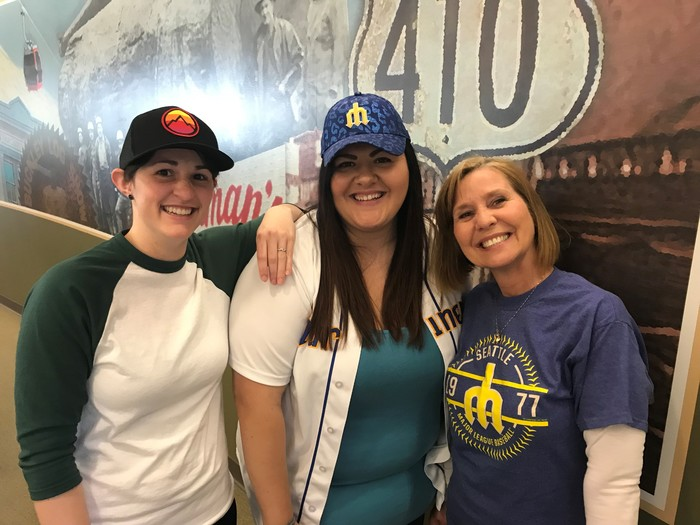 Three WRCU team members pose together for a photo, all wearing baseball clothing