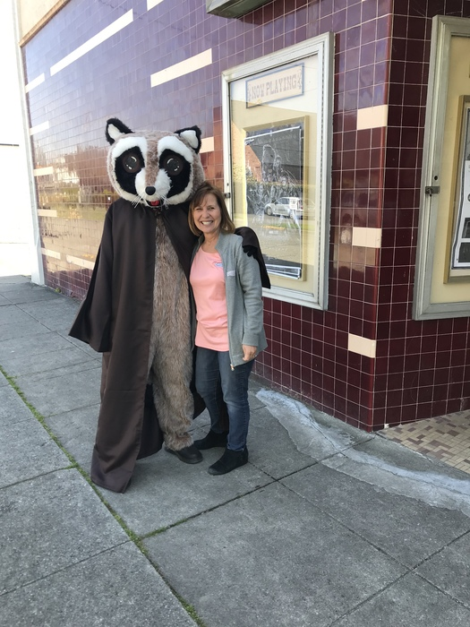 Rocky Racoon posing for picture with woman outside the Chalet Theater