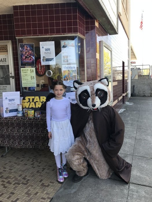Rocky Raccoon posing with girl dressed as Princess Leia