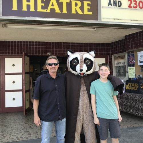 Rocky posing for picture with man and boy outside the Chalet Theater