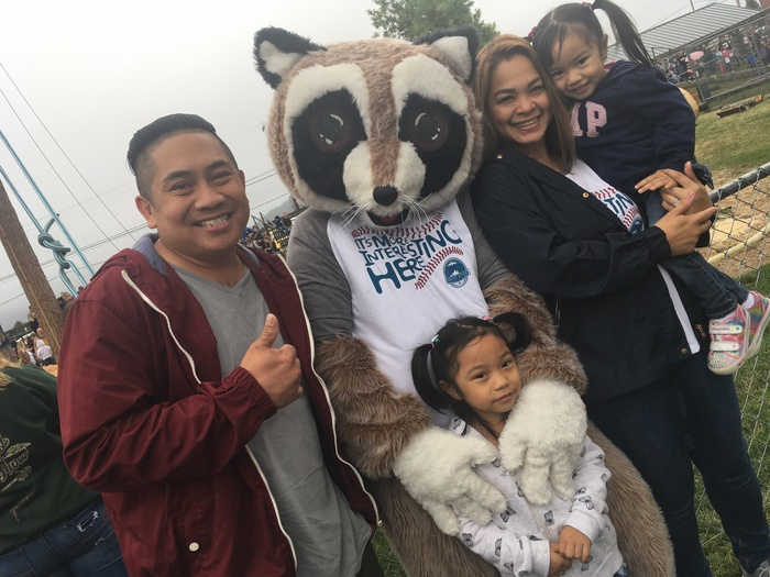 Rocky Raccoon posing with young family