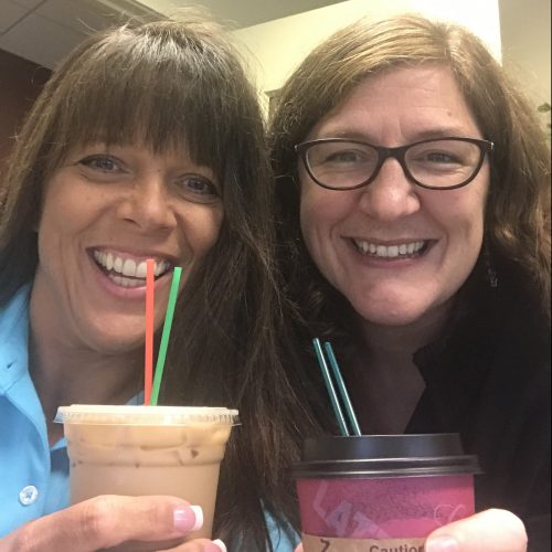 Two WRCU employees posing with coffee from Mocha Motion