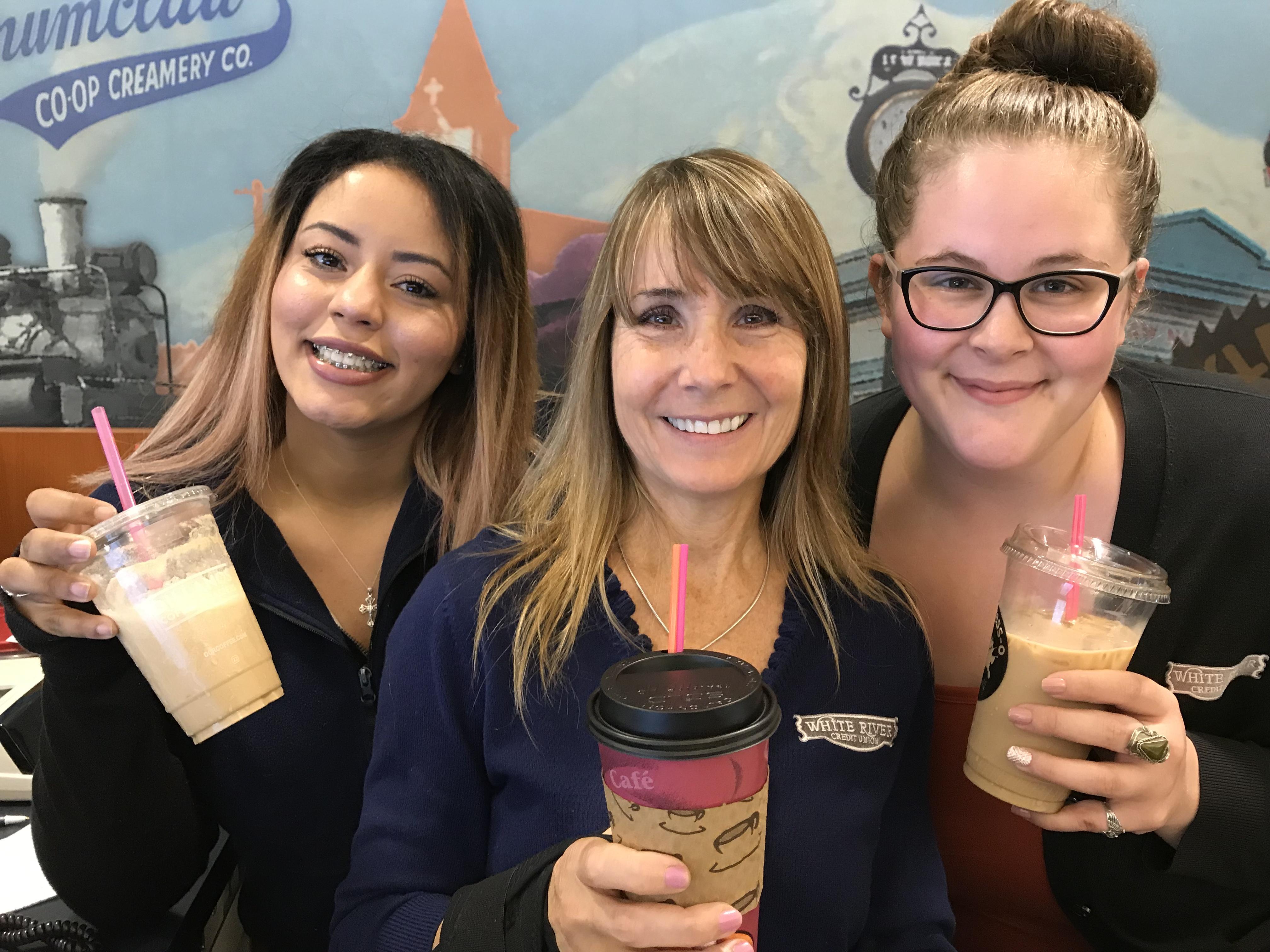 Three WRCU employees posing with coffee from Mocha Motion