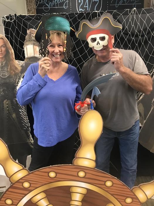 WRCU members posing in front of pirate wheel at WRCU