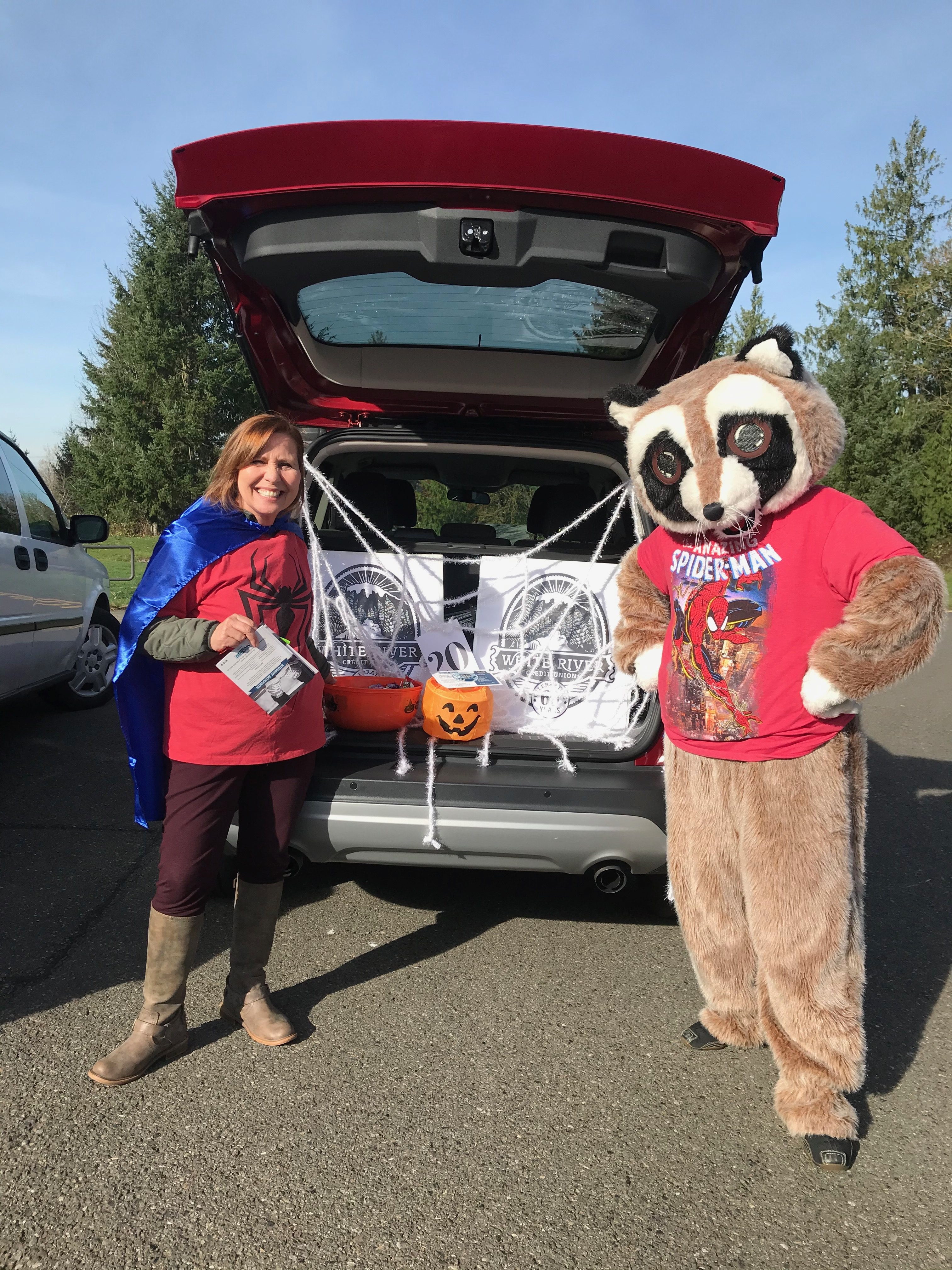 White River Credit Union employee and Rocky posing at MRCC MOPs Annual Trunk or Treat