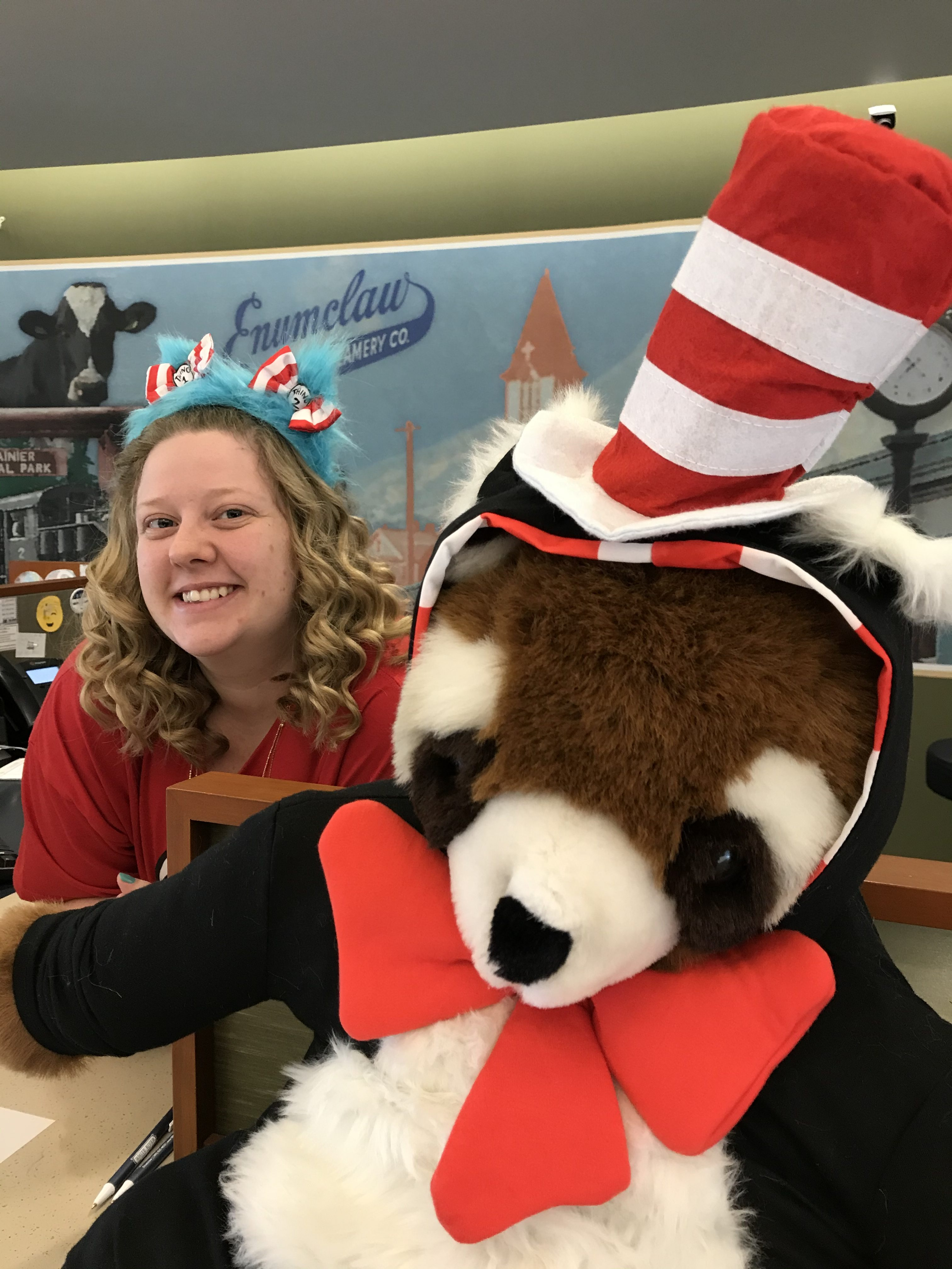 White River Credit Union employee dressed up and posing with a stuffed animal on Halloween