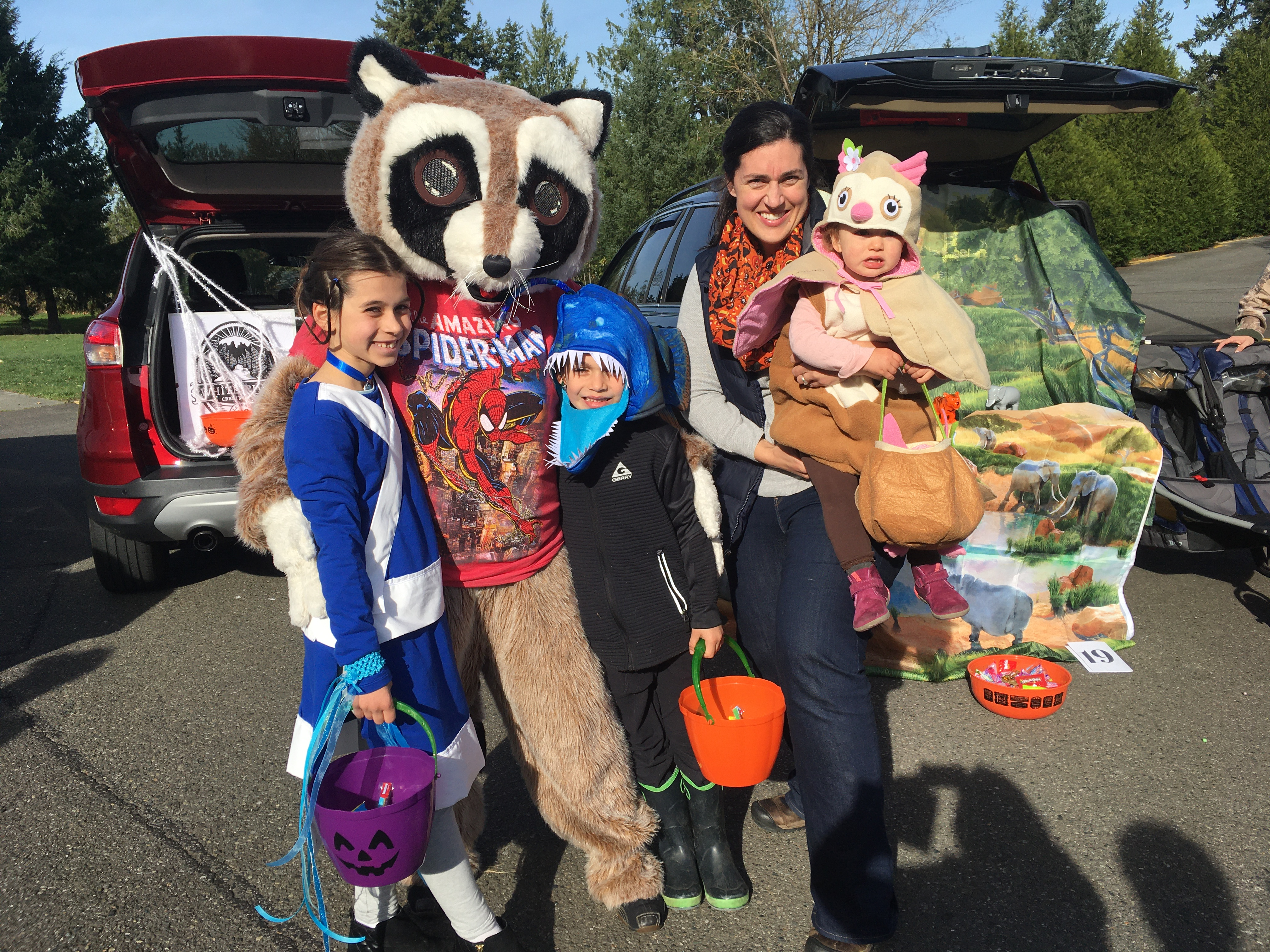 Rocky and Enumclaw community members posing at MRCC MOPs Annual Trunk or Treat dressed up in Halloween costumes